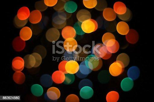 istock Defocused Multi Colored Lights. Christmas lights 882624580