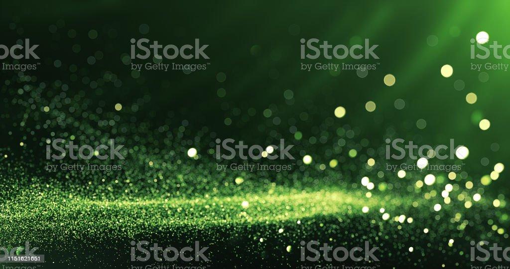 去聚焦粒子背景(綠色) - 免版稅亮粉圖庫照片