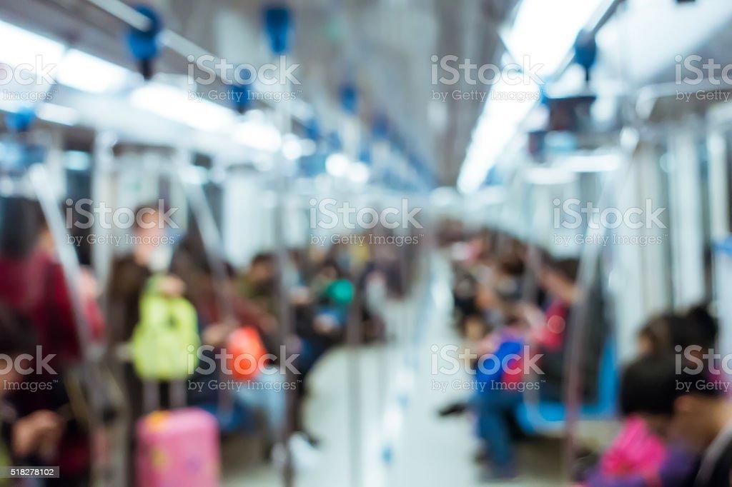 Defocused people in subway stock photo