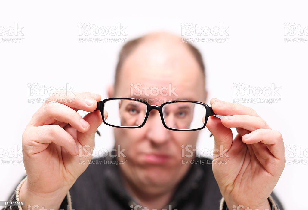 Defocused person holding glasses royalty-free stock photo