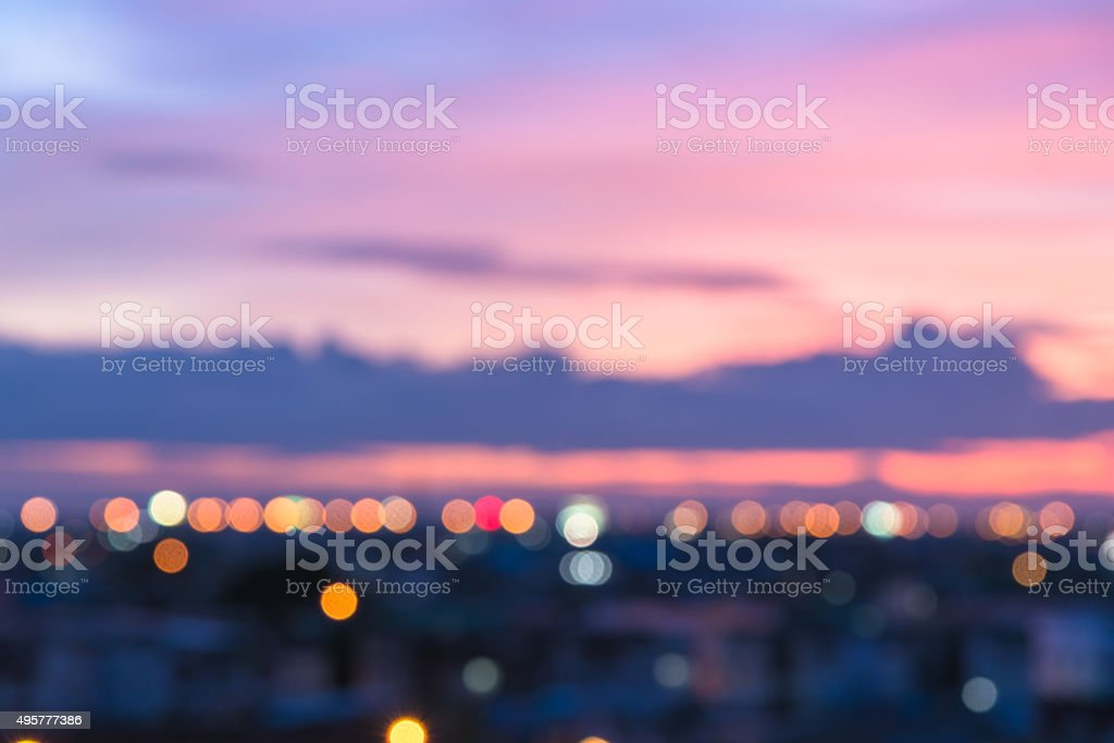 Defocused pink sky and city light stock photo