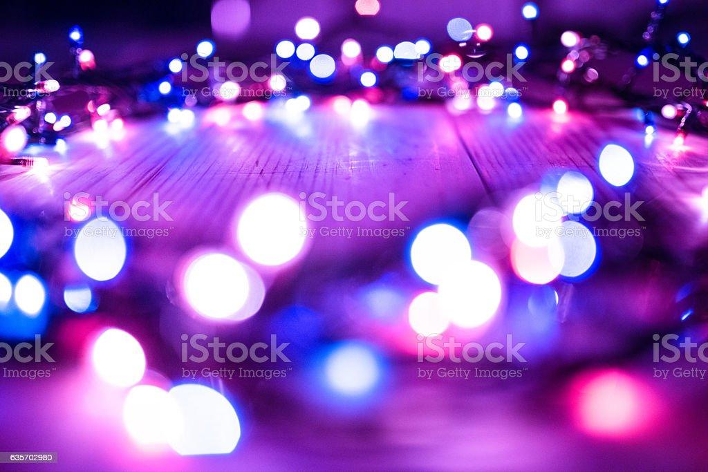 defocused purple christmas lights royalty-free stock photo