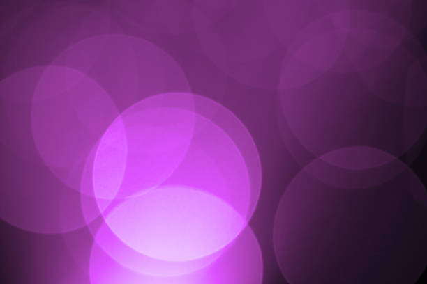 defocused purple holiday light background - disco lights stock photos and pictures