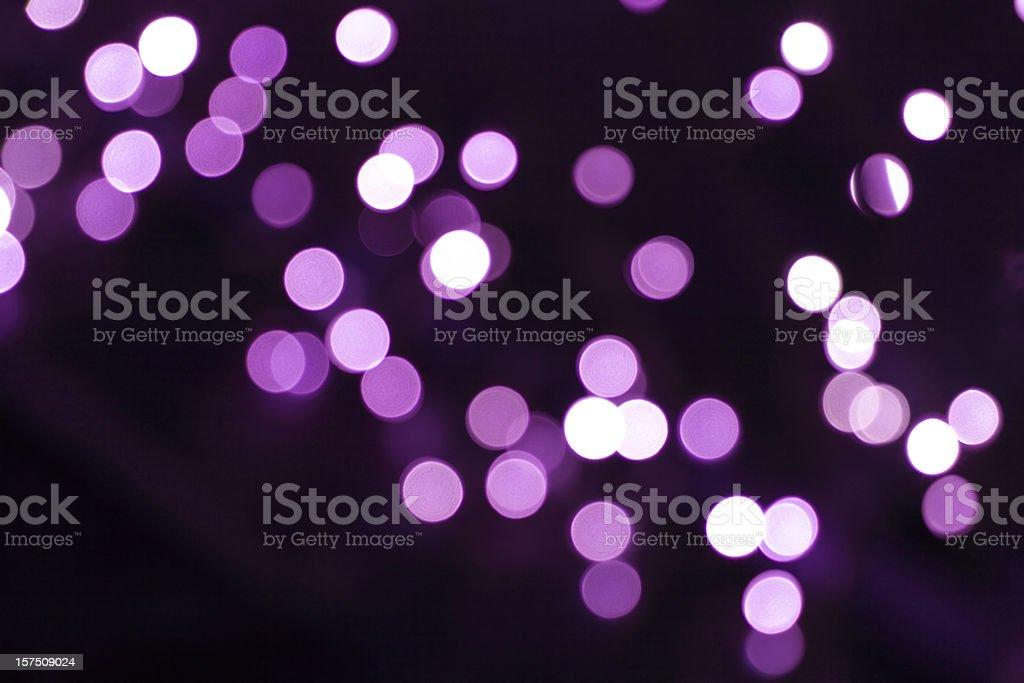 defocused purple light dots against black background royalty-free stock photo
