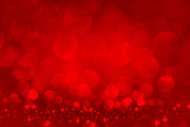 Defocused red lights and glitter stock photo