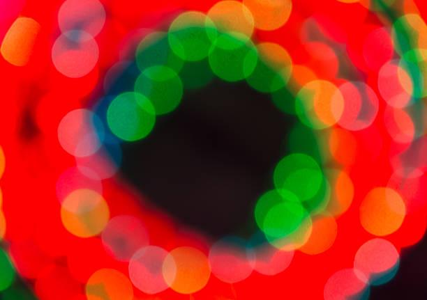 unscharf gestellt lichter in seil circle. - lichtschlauch stock-fotos und bilder