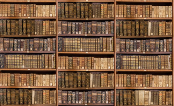 Defocused shelves of old antique books for background stock photo