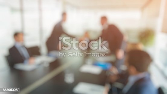 635949862 istock photo Defocused shot of businessmen shaking hands at a meeting 635950082