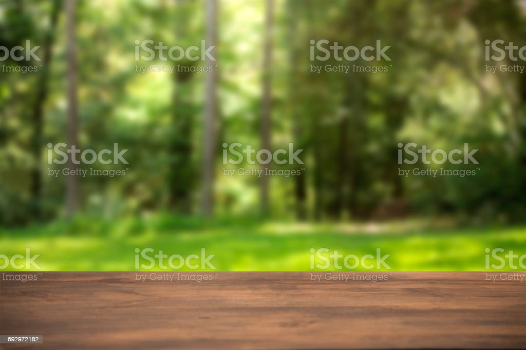 Defocused summer scene with blank table. stock photo