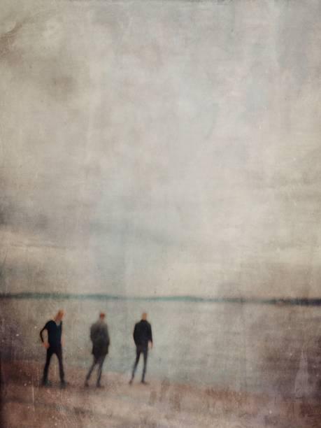 Defocused textured view of the men in the coastline