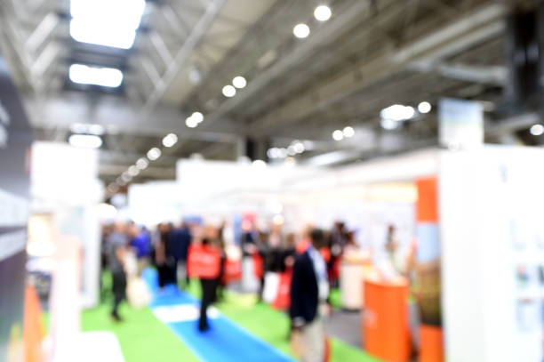 Defocused Tradeshow Defocused Tradeshow attending stock pictures, royalty-free photos & images