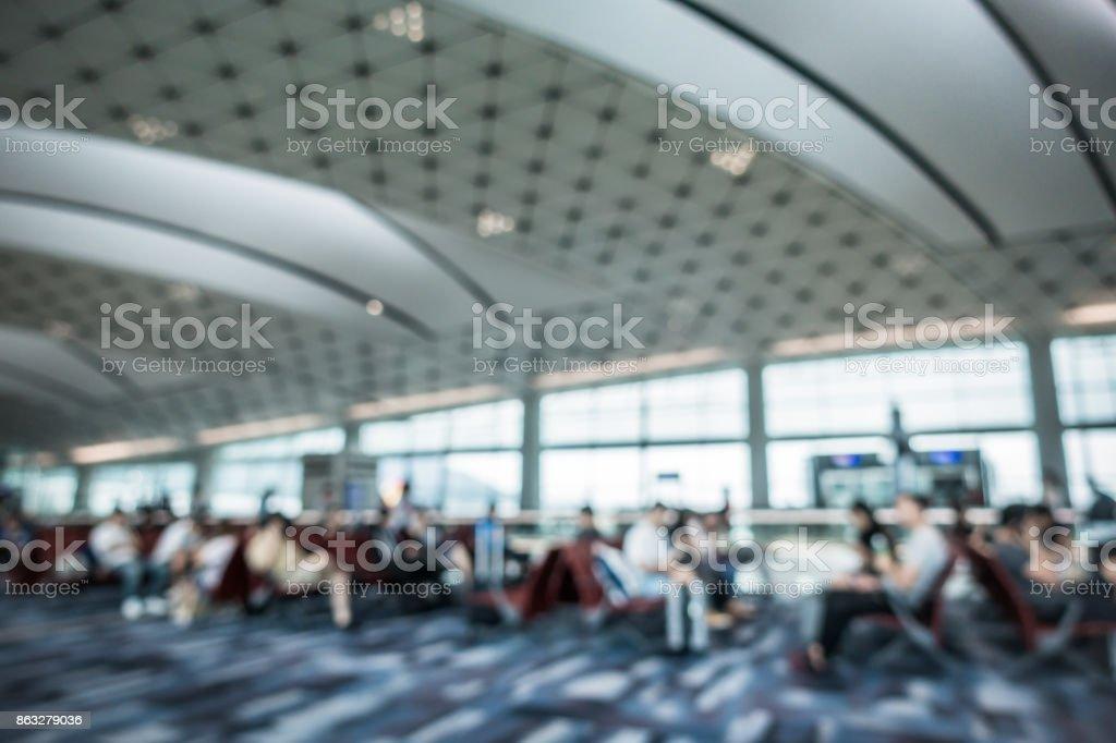 Defocused Travellers Waiting at the Airport Departure Gate stock photo