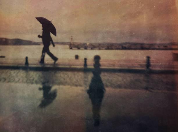 Defocused view of man walking in the rain