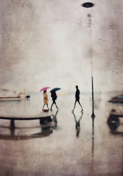 Defocused view of the people in the rain