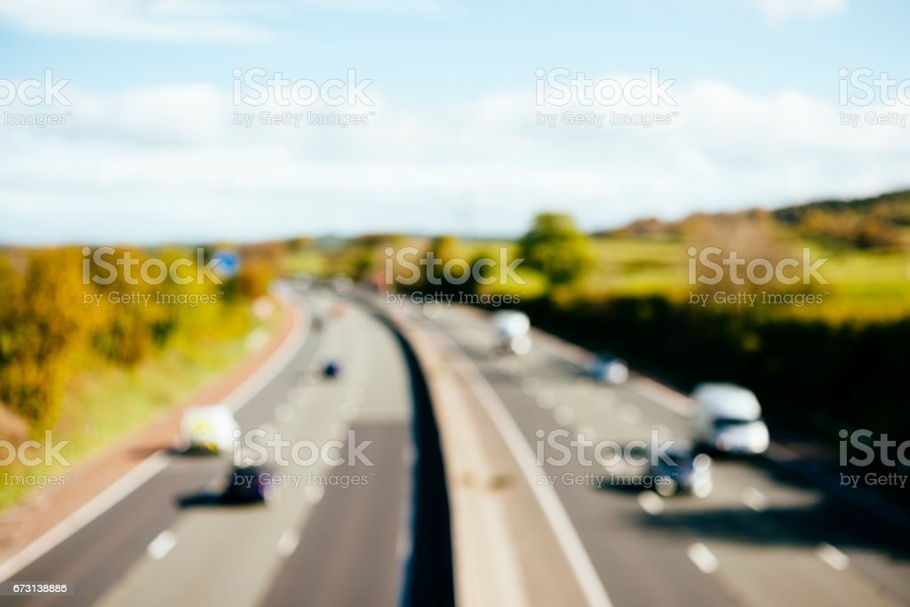 defocused views over the M6 motorway on bright sunny morning. stock photo