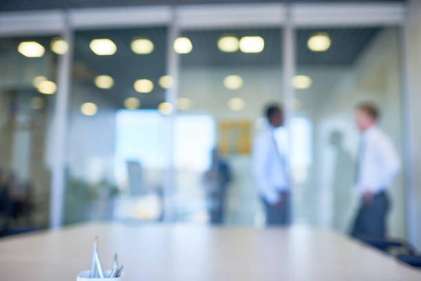 defocused workplace - incidental people stock pictures, royalty-free photos & images