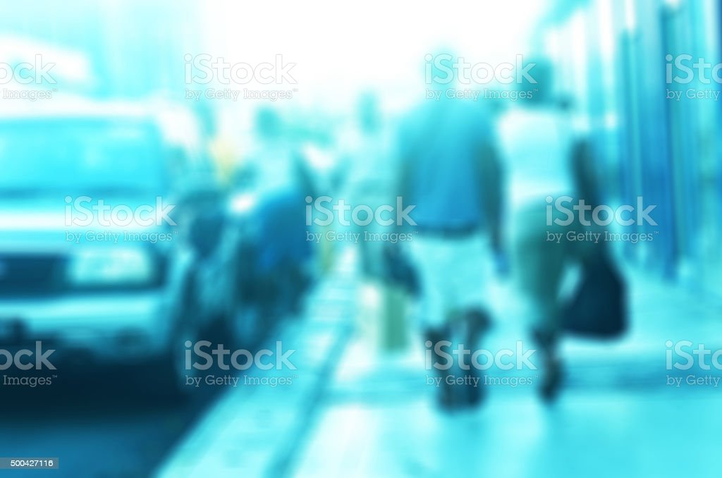 defocussed people walking and shopping on city street stock photo