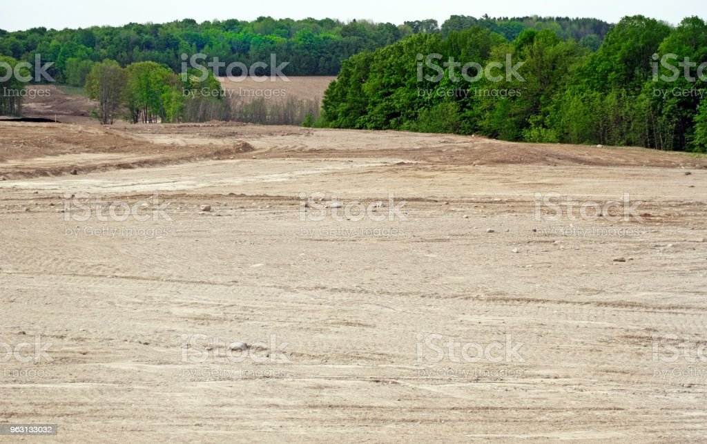 Deforestation of trees and land leveled and graded to make way for a new subdivisiongraded to pre stock photo