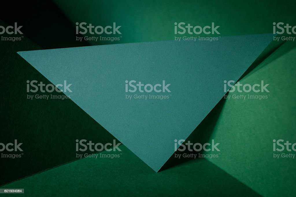 deformed green paper background. stock photo