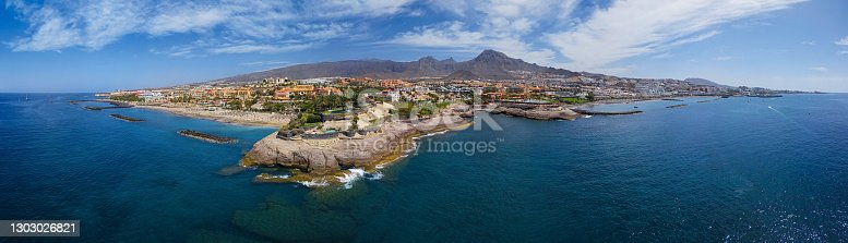 istock 180 degree aerial panorama of Costa Adeje resort and Playa del Duque beach, Tenerife, Canary islands, Spain. 1303026821