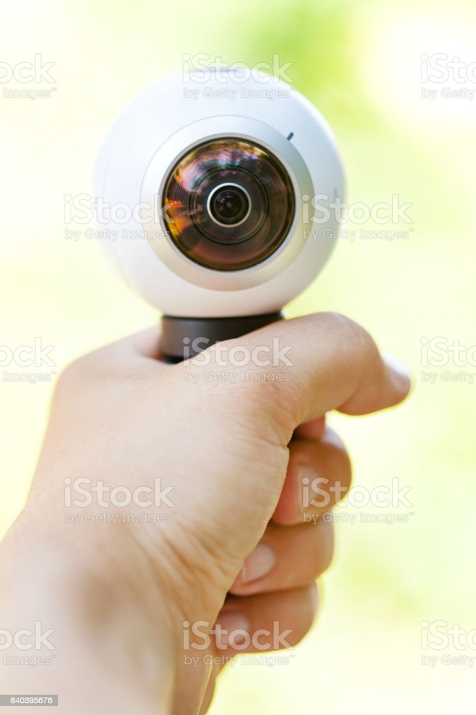 360 degree panoramic camera in human hand stock photo