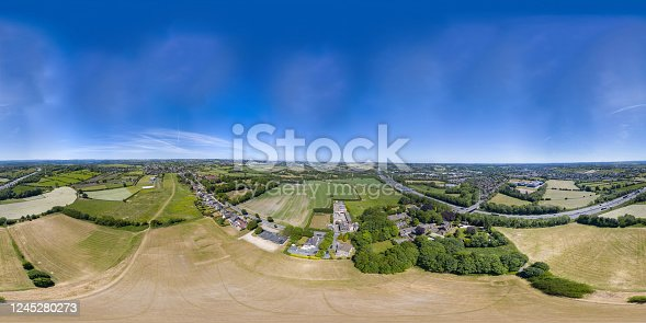 istock 360 Degree panoramic sphere aerial photo of the UK village of Cleckheaton in Bradford West Yorkshire in the UK showing farmers fields along side the M63 Motorway in a bright sunny summers day 1245280273