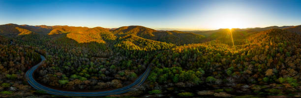 360 degrees aerial panorama of fall landscape in Georgia Mountains with sun rays stock photo