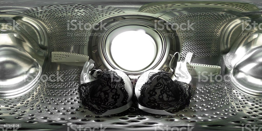 360 degrees spherical panorama  inside a washing machine with lingerie stock photo