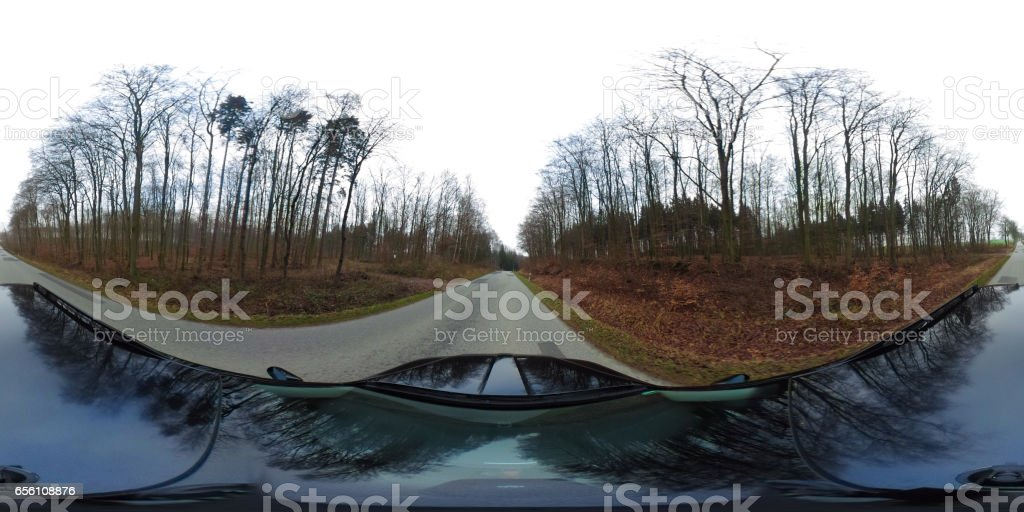 360 degrees spherical panorama of a driving car on a country road in germany stock photo