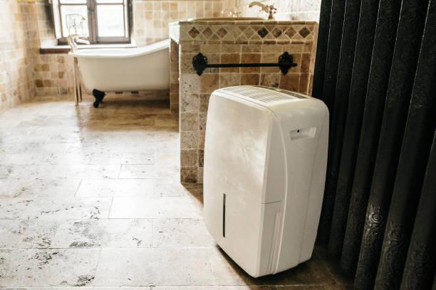 Dehumidifier in a bathroom stock photo