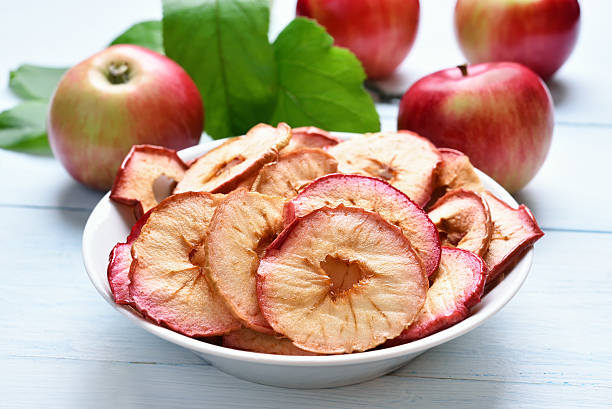 dehydrated apples chips - dried fruit stock photos and pictures