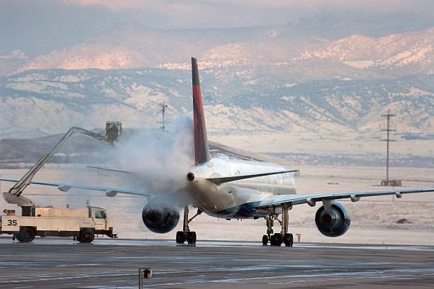 Deicing airplane during winter Denver Colorado stock photo