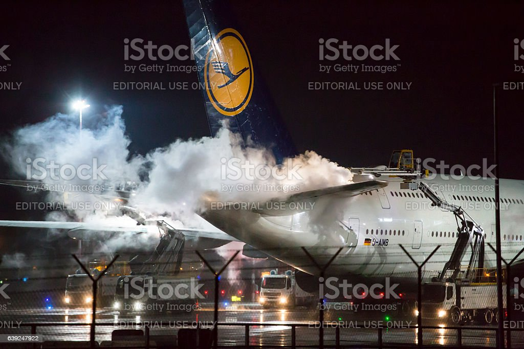De-icing of an airplane at Frankfurt Airport stock photo
