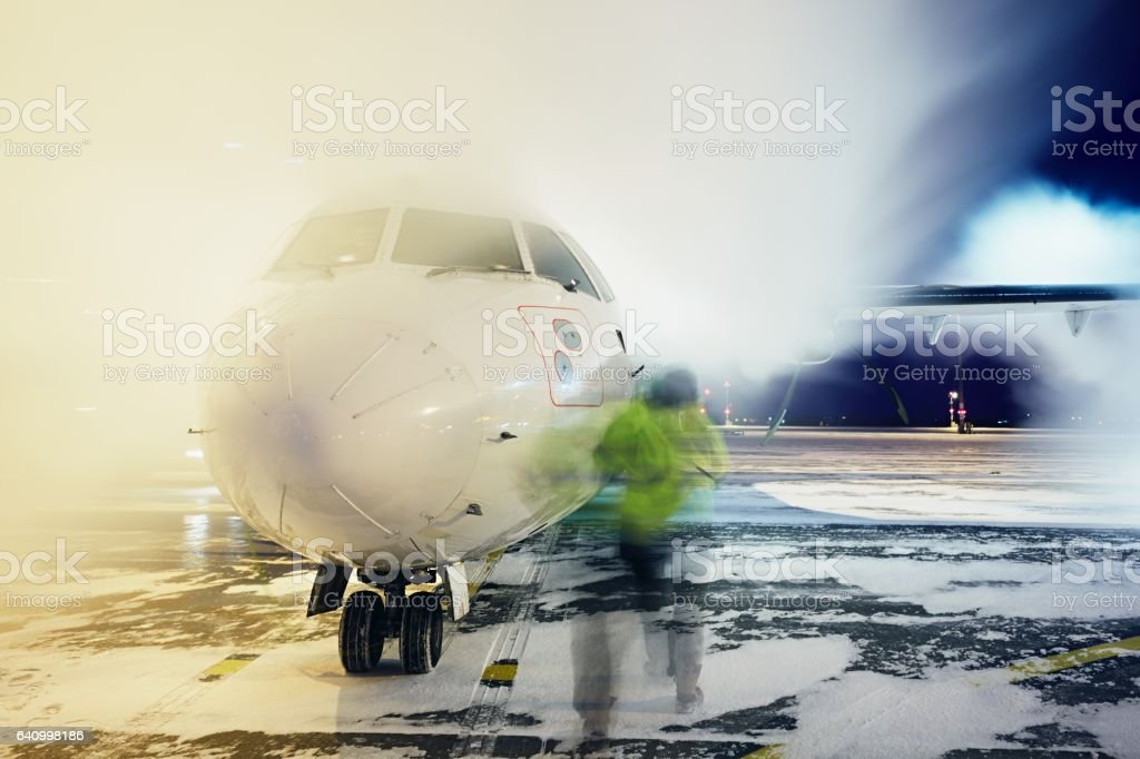 Deicing of the airplane stock photo