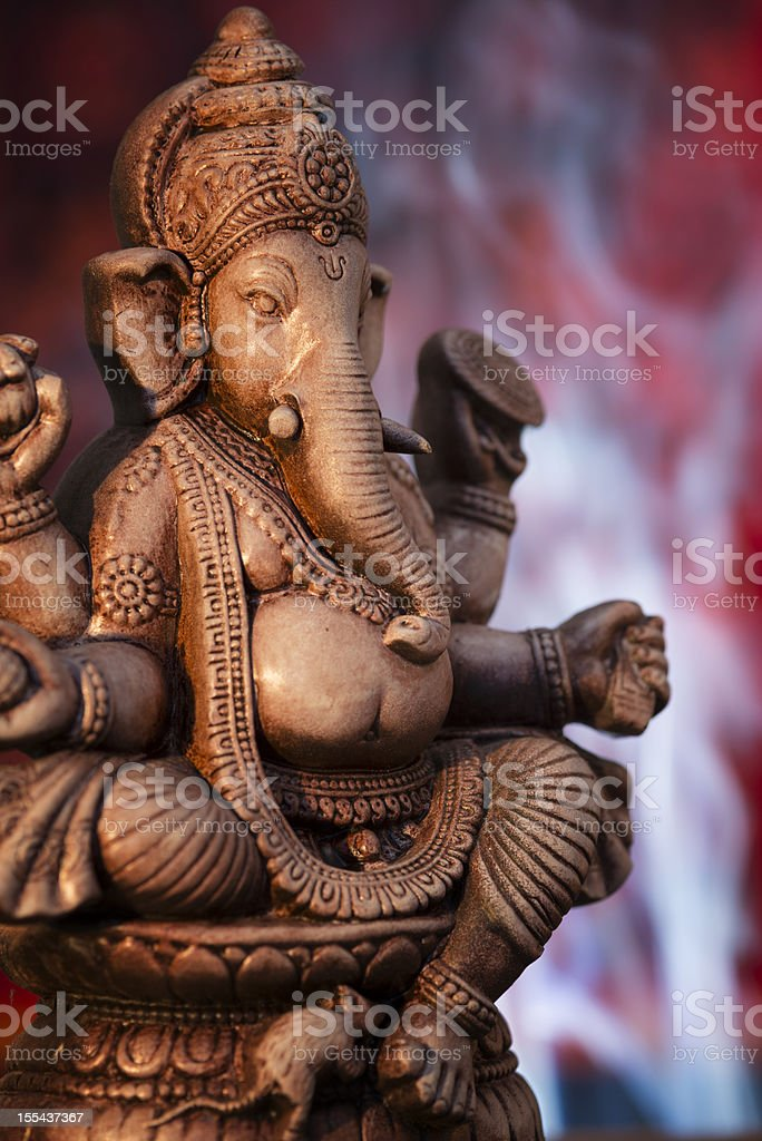 Deity of Ganesha from India on red background stock photo