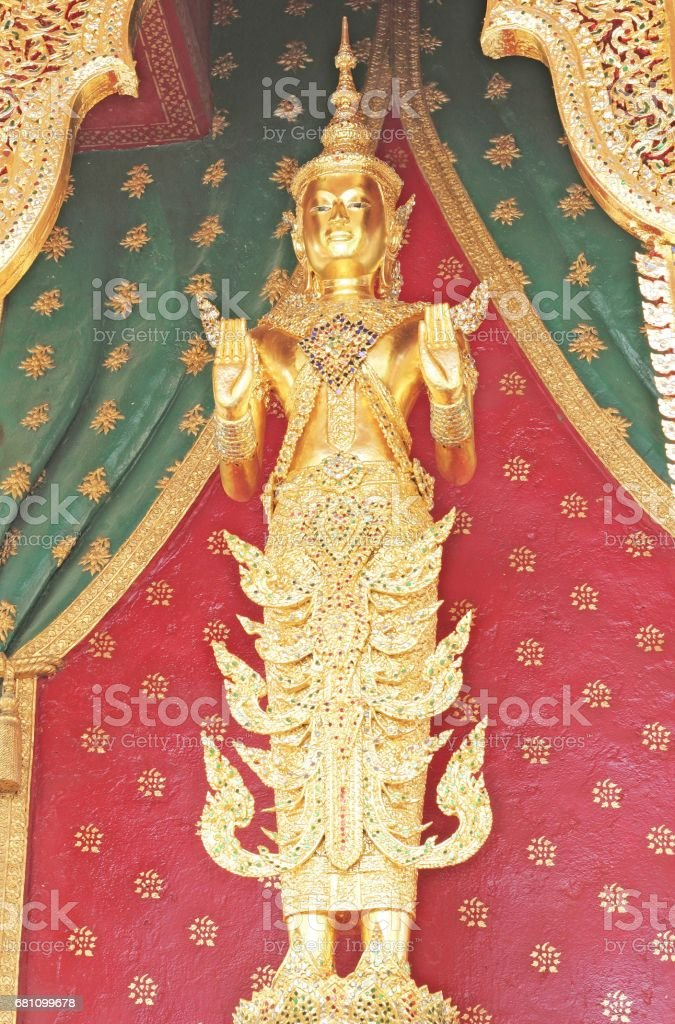 deity statue in front of the church stock photo