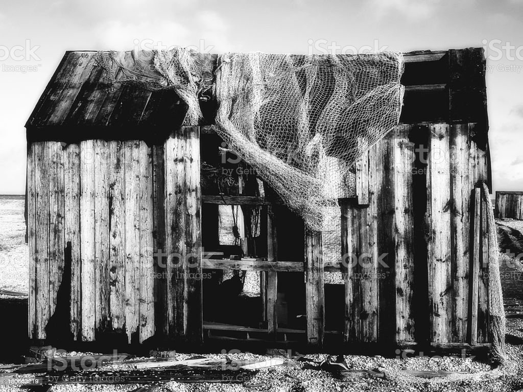 Delapadated  fishing hut at Dungeoness Kent in monochrome infrared royalty-free stock photo