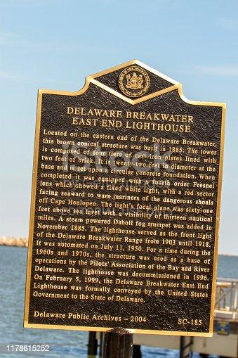 Lewes, Delaware - September 27, 2019 :  Historical marker describing the Delaware Breakwater East End Lighhouse in Delaware Bay.