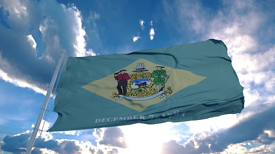 Delaware flag on a flagpole waving in the wind in the sky. State of Delaware in The United States of America. 3d rendering