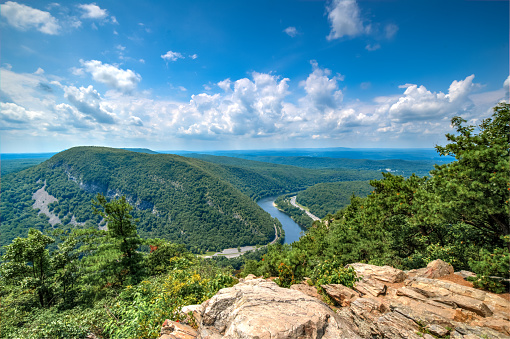 View of the Delaware Water Gap from the overlook near the summit of Mount Tammany.  The Delaware Water Gap is a water gap on the border of the of New Jersey and Pennsylvania where the Delaware River cuts through a large ridge of the Appalachian Mountains.