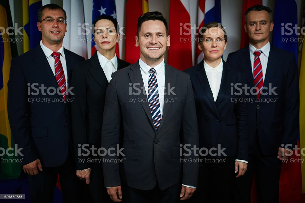 Delegate executive with colleagues stock photo