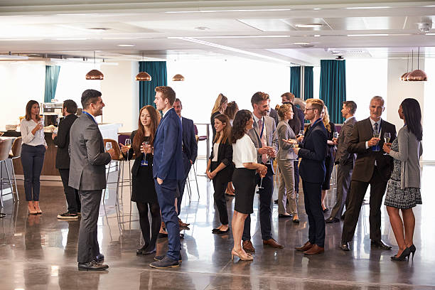 delegates networking at conference drinks reception - reunión evento social fotografías e imágenes de stock