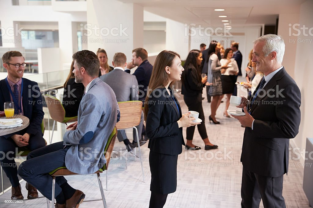 Delegates Networking During Coffee Break At Conference stock photo