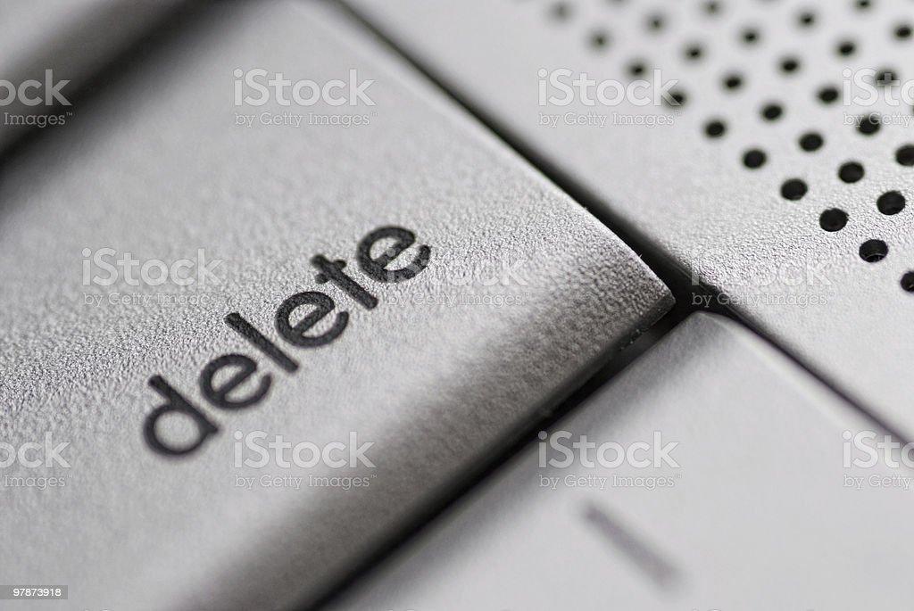 delete button on a silver laptop stock photo