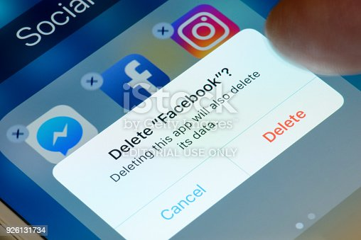 Antibes, France - February 21, 2018: User deletes Facebook app from iPhone. The social media platform faces increased scrutiny around personal data privacy and its handing of fake news and extremist content.