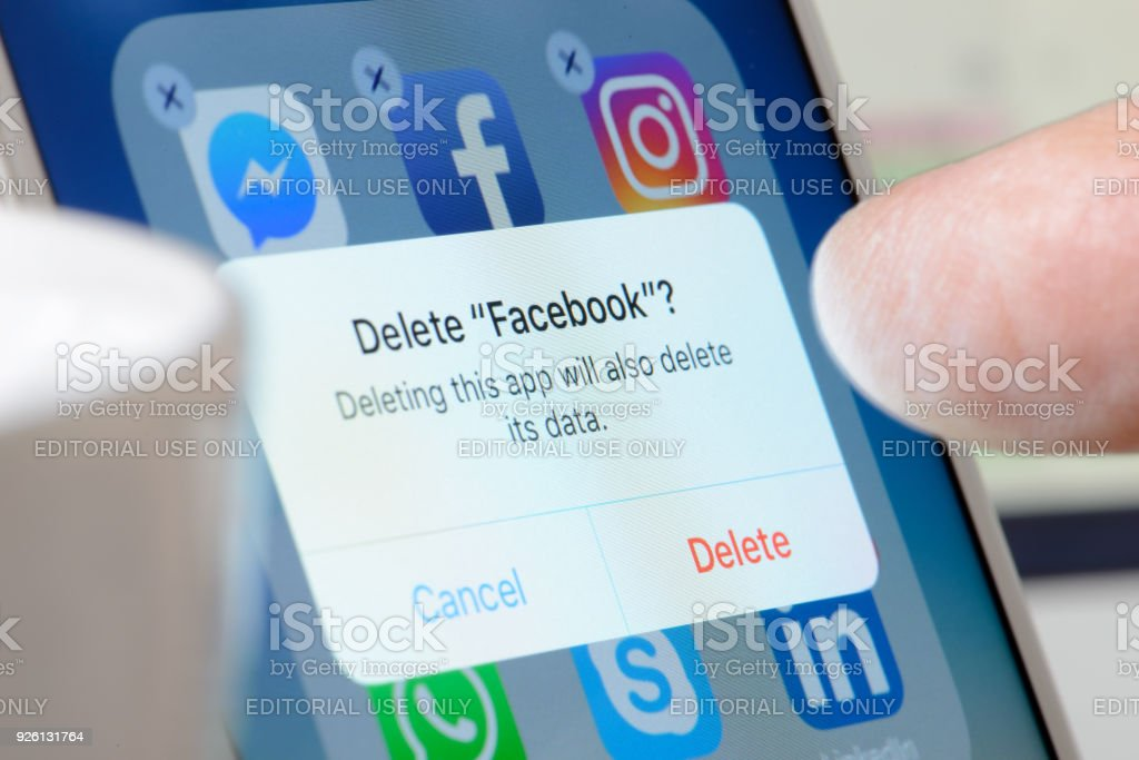 Deleting Facebook App from Smartphone stock photo