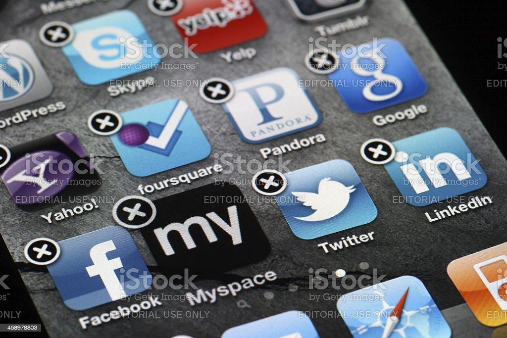 Deleting Myspace App - iPhone 4 stock photo