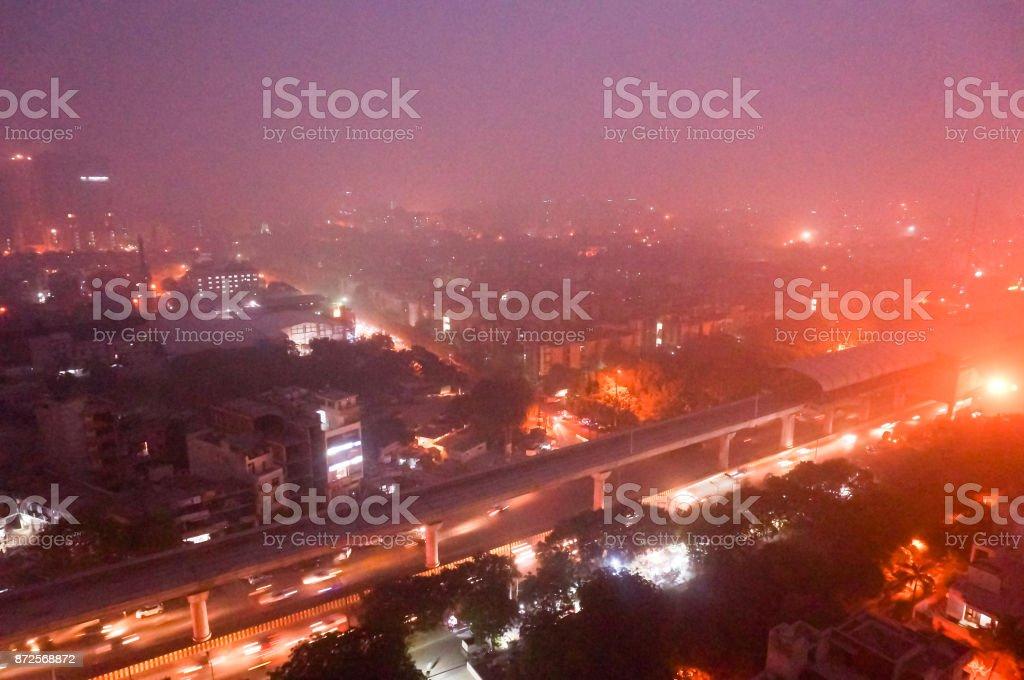 Delhi Noida Gurgaon with heavy pollution smog at dusk stock photo