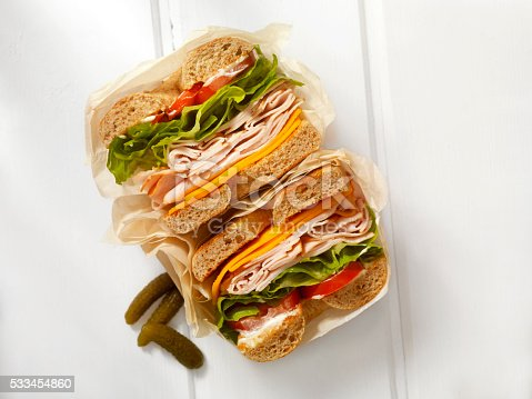 Deli Style Turkey Bagel Sandwich with Cheddar Cheese, Lettuce,Tomato and Mayo - Photographed on a Hasselblad H3D11-39 megapixel Camera System