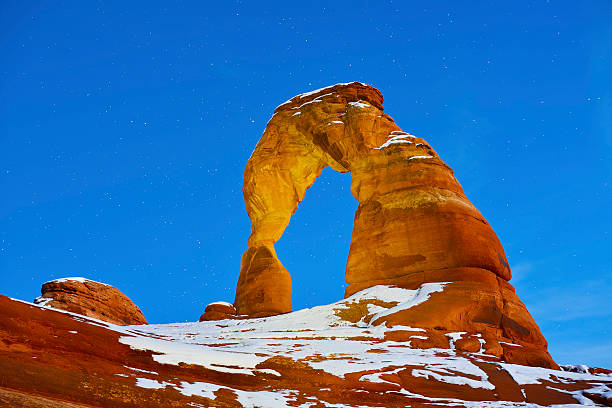 Delicate Arch at night Delicate Arch at night in Arches National Park, Utah in winter delicate arch stock pictures, royalty-free photos & images